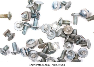 pile of  metal screw and new nuts isolated on white background