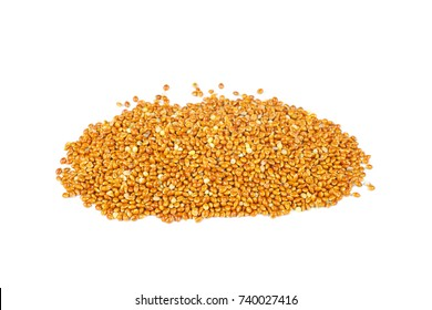 Pile of millet seeds isolated on white background