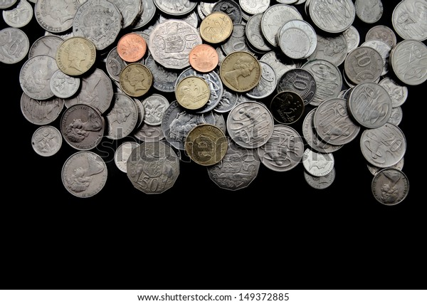 Pile of mixed australian coins currency on black background