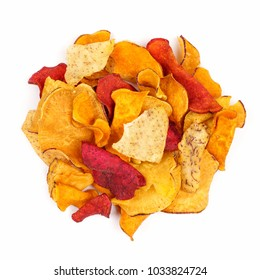 Pile of mixed healthy vegetable chips. Top view, isolated on a white background.