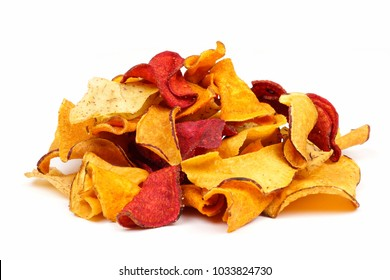 Pile of mixed healthy vegetable chips. Side view, isolated on a white background.