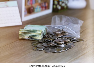 Pile of money coins closeup on table blur background