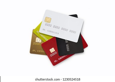Pile of multicolored credit cards on white background