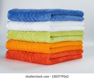 Pile of Multicolored towels on a white background