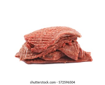 Pile of multiple tenderized slices of raw beef meet isolated over the white background