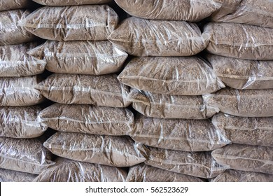 Pile of natural fertilizer bags Stacks In Warehouse, selective focus