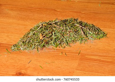 A pile of needles from a Christmas tree on the floor