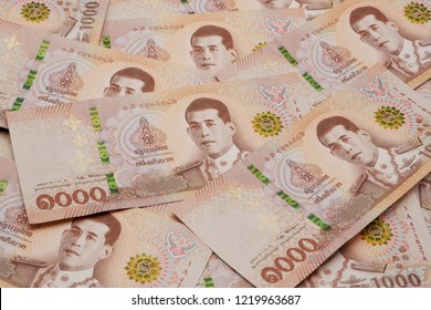 Pile of new 1000 Thai Baht banknotes. Business and finance concept.