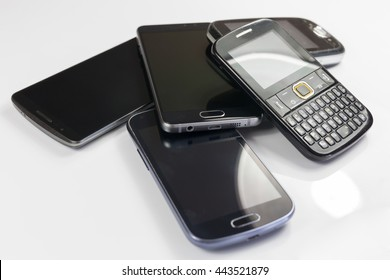 Pile of new and old mobile phones
