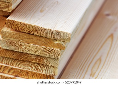 Pile of new wooden boards on a storage