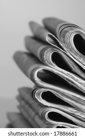 pile of news papers on white background