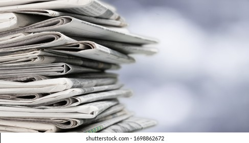 Pile of newspapers on blur background