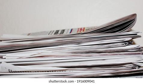 Pile of newspapers on white background. gazete.   türk gazeteleri.