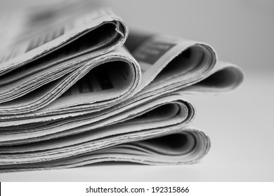 Pile of newspapers, processed in black and white