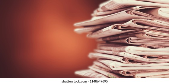 Pile of newspapers stack on background