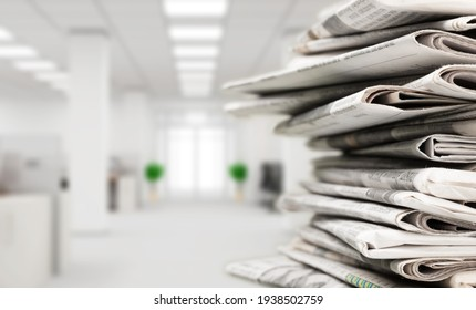 Pile of newspapers stacks on blur background