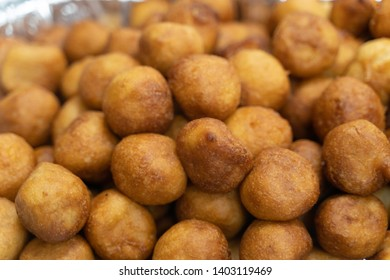 Pile of Nigerian Puff Puff served at party