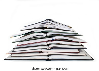 pile of notebooks on a white background
