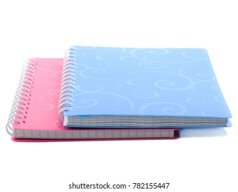 A pile of notebooks with spiral binding of sheets. Isolated on white.
