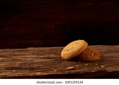 Pile of oat cookies on wooden table, close-up, selective focus.