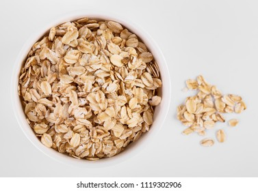 pile of oatmeal isolated on white background. Creative layout made of organic oatmeal isolated on white background. Food concept.