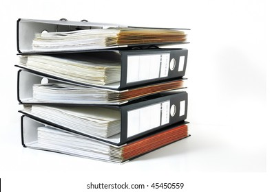 Pile of office ring binders with tax documents on white background