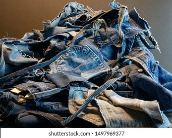 Pile of old blue jeans ready to be recycled.