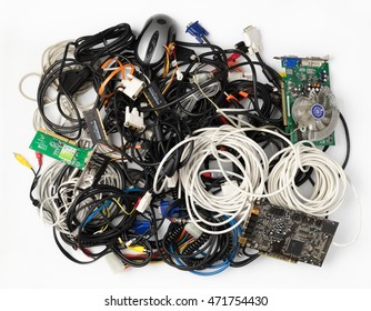 Pile of old cables and computer components on a white background.