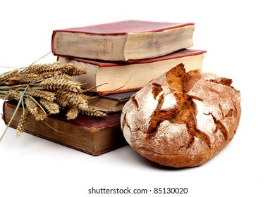 Pile of old cookingbooks and fresh baked bread