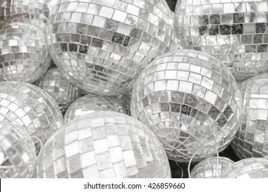 A pile of old dirty disco balls with stained, texture / pattern, soft focus, abstract