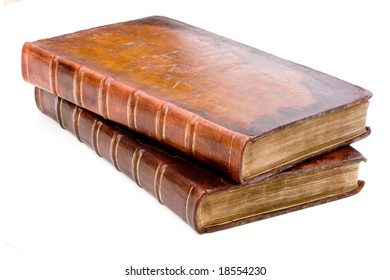 A pile of old leather bound books isolated on a white background