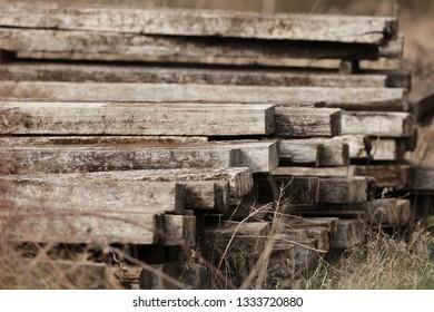 A pile of old railway sleepers
