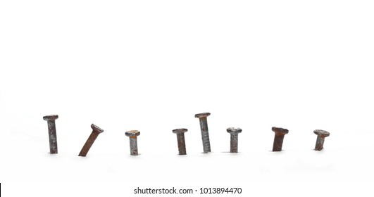 Pile of old, rusty nailed metal nails isolated on white background