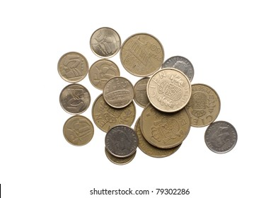 """Pile of old spanish coins (""""pesetas"""", pre-euro), isolated on white background."""
