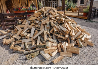 a pile of old split wood to kindle a fire