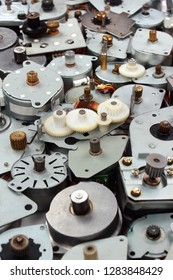 Pile of old stepper motors as industrial e-waste background