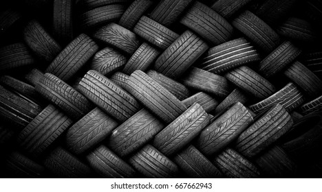 Pile of old tires neatly arranged.