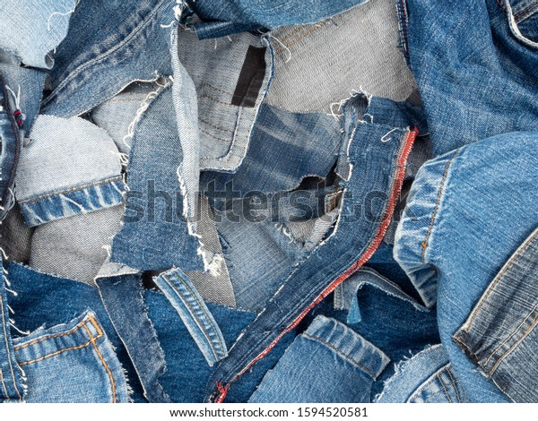 Pile of old used jeans ready to be recycled.
