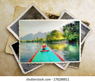 pile of old vintage photographs with on top a colorful image from a canoe on a river surrounded with amazing mountains