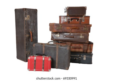 Pile of old vintage suitcases - luggage isolated on white