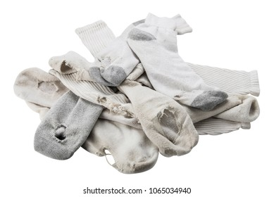 Pile of old white socks with holes, isolated on white.