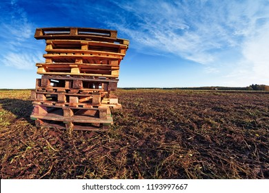 A pile of old wooden pallets on the fields of the rural Finland. They are waiting for the harvesting farmer and his tools.