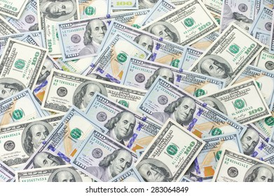 Pile of one hundred dollar bills new and old design. Top view point.