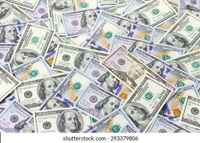 Pile of one hundred dollar bills new and old design and fifty dollar bills.