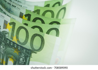 Pile of one hundred euro banknotes isolated on white background. Stack of hundred Euro bills use for money background and financial concepts.