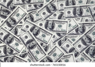 A pile of one hundred US banknotes with president portraits. Cash of hundred dollar bills, dollar background image with high resolution