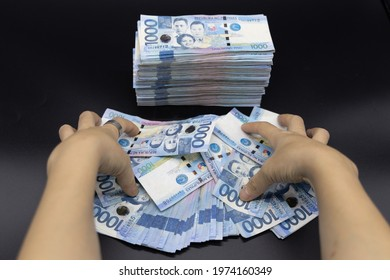 A pile of one thousand Philippines banknotes. Cash of Thousand dollar bills, Peso background image.