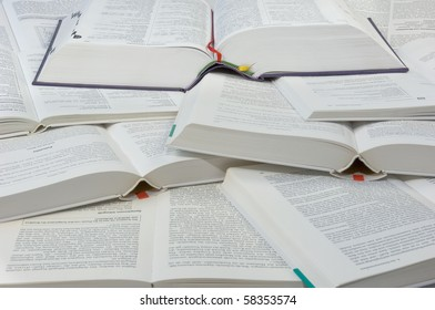 A pile of open books