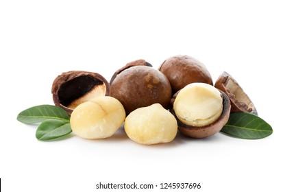 Pile of organic Macadamia nuts on white background