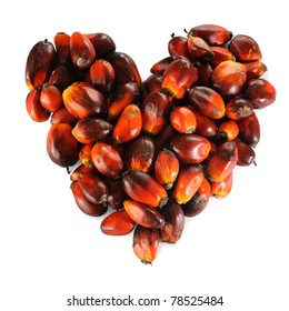 Pile of Palm Oil seeds in heart shape isolated on a white background.
